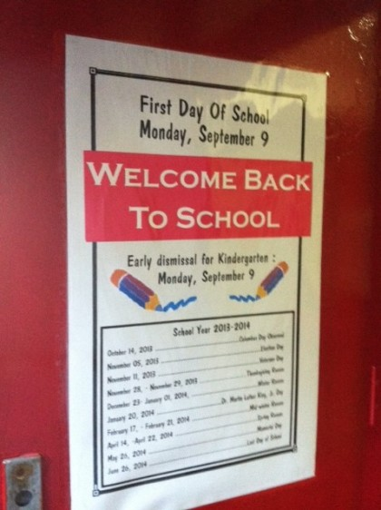 The NYC school calendar of the days off  on the welcome back to school poster on the front door of PS33 Chelsea Prep School in District 2 Manhattan