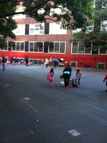 Parents walking through the P.S. 33 Chelsea Prep school playground getting ready to drop off their children for the first day of school!