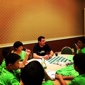PS 33 Chelsea Prep with Coach Russ getting pumped up before the chess tournament begins.